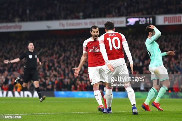 Henrikh Mkhitaryan of Arsenal celebrates after scoring his team's second goal with Mesut Ozil of Arsenal during the Premier League match between...