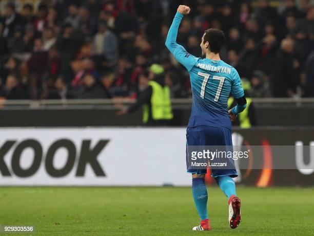 Henrikh Mkhitaryan of Arsenal celebrates after scoring the opening goal during UEFA Europa League Round of 16 match between AC Milan and Arsenal at...