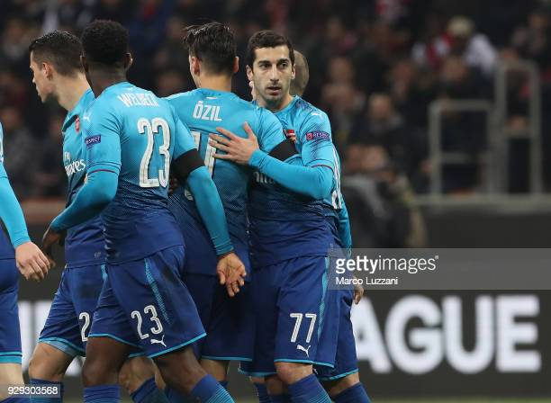 Henrikh Mkhitaryan of Arsenal celebrates with his teammates after scoring the opening goal during UEFA Europa League Round of 16 match between AC...