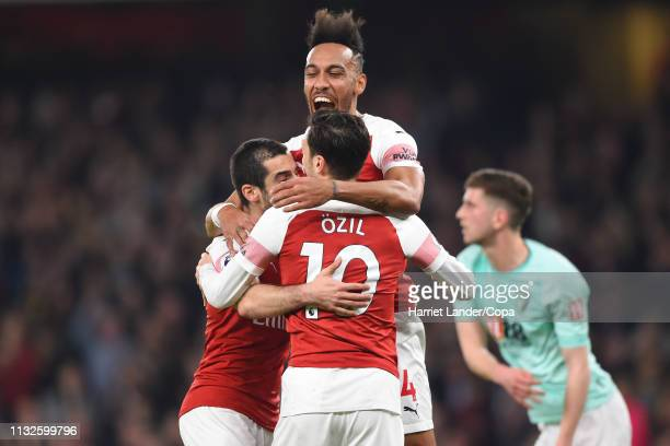 Henrikh Mkhitaryan of Arsenal celebrates with teammates after scoring his team's second goal during the Premier League match between Arsenal FC and...