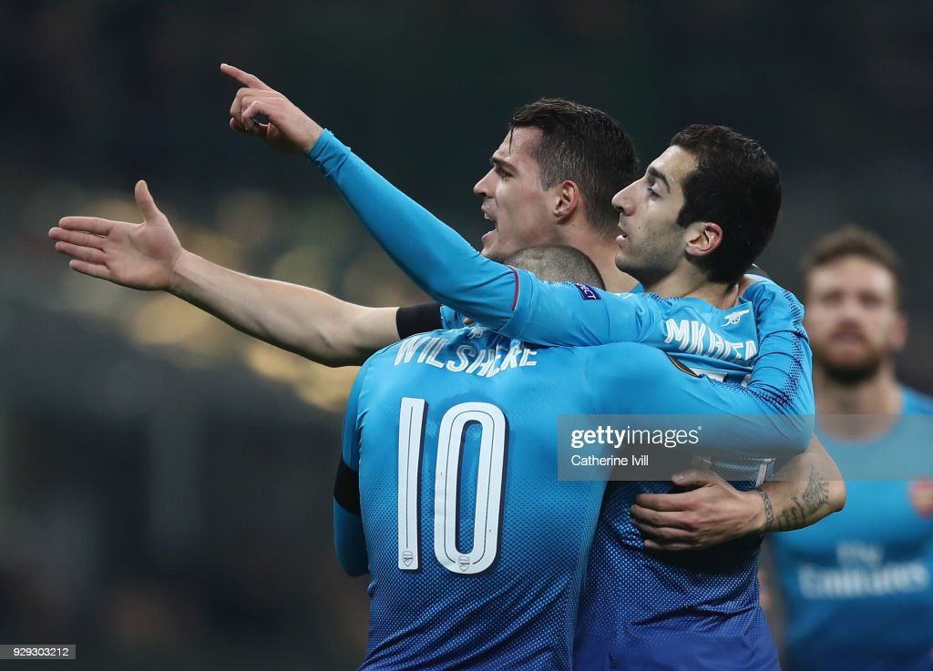 Henrikh Mkhitaryan of Arsenal celebrates with team-mates after scoring during the UEFA Europa League Round of 16 match between AC Milan and Arsenal at the San Siro on March 8, 2018 in Milan, Italy.