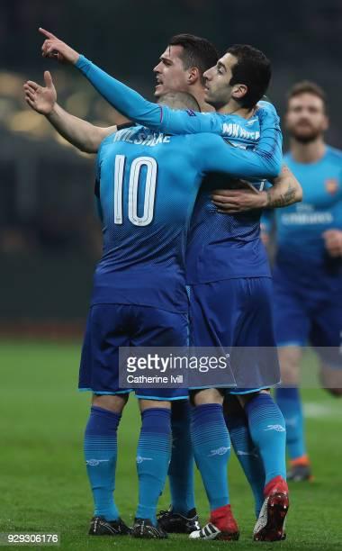 Henrikh Mkhitaryan of Arsenal celebrates with teammates after scoring during the UEFA Europa League Round of 16 match between AC Milan and Arsenal at...