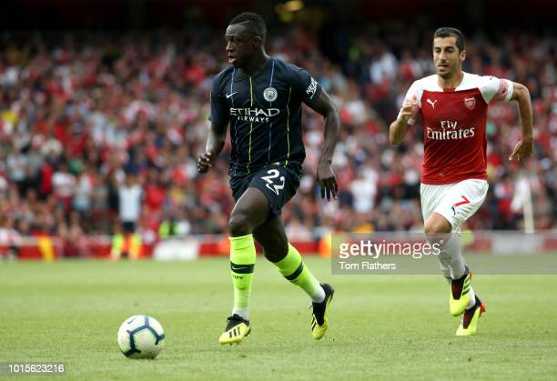 Henrikh Mkhitaryan of Arsenal chases down Benjamin Mendy of Manchester City during the Premier League match between Arsenal FC and Manchester City at...