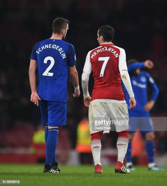 Henrikh Mkhitaryan of Arsenal chats to Morgan Schneiderlin of Everton after the match the Premier League match between Arsenal and Everton at...