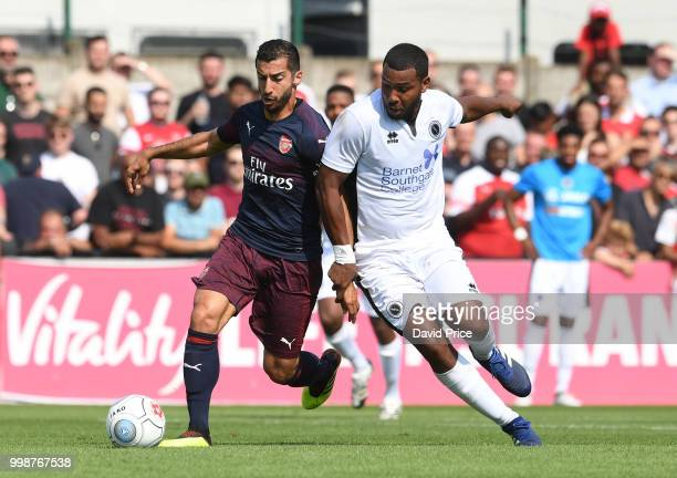 Henrikh Mkhitaryan of Arsenal competes for the ball with Morgan Ferrier of Borehamwood during the match between Borehamwood and Arsenal at Meadow...