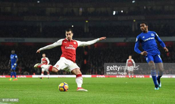 Henrikh Mkhitaryan of Arsenal crosses the ball leading to his sides first goal during the Premier League match between Arsenal and Everton at...
