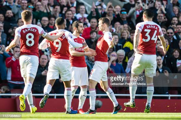Henrikh Mkhitaryan of Arsenal FC celebrates with his team mates Alexandre Lacazette and Stephan Lichtsteiner after scoring a goal during the Premier...
