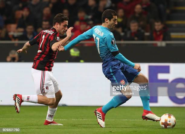 Henrikh Mkhitaryan of Arsenal FC competes for the ball with Davide Calabria of AC Milan during UEFA Europa League Round of 16 match between AC Milan...