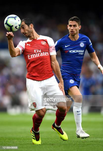 Henrikh Mkhitaryan of Arsenal heads the ball under pressure from Jorginho of Chelsea during the Premier League match between Chelsea FC and Arsenal...