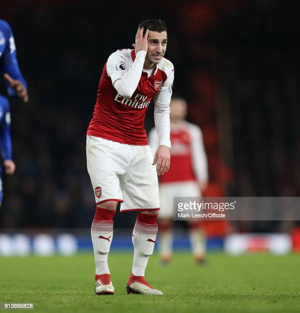 Henrikh Mkhitaryan of Arsenal holds his head after a collision during the Premier League match between Arsenal and Everton at Emirates Stadium on...