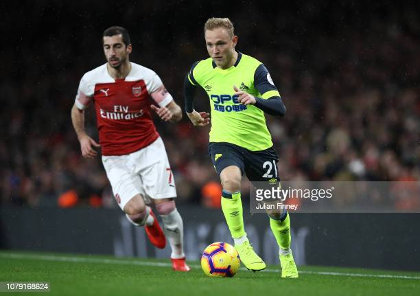 Henrikh Mkhitaryan of Arsenal in action with Alex Pritchard of Huddersfield during the Premier League match between Arsenal FC and Huddersfield Town...