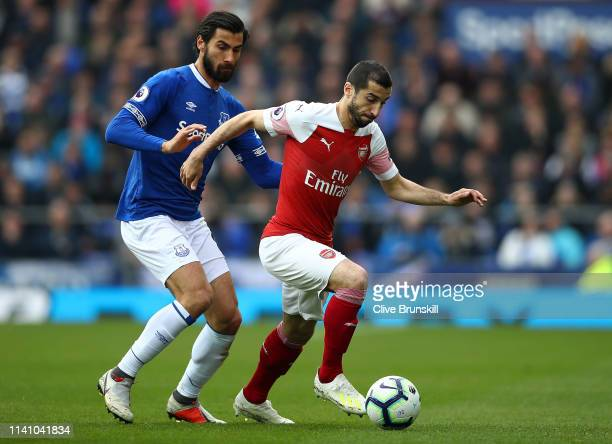 Henrikh Mkhitaryan of Arsenal in action with Andre Gomes of Everton during the Premier League match between Everton FC and Arsenal FC at Goodison...