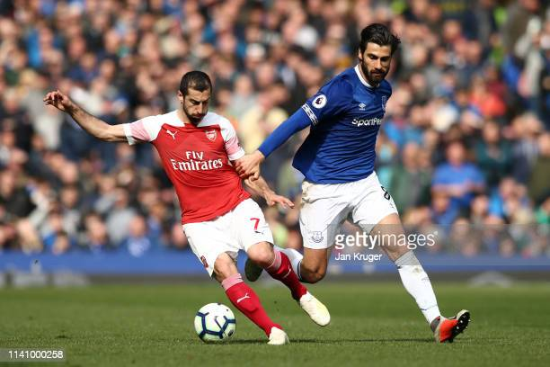 Henrikh Mkhitaryan of Arsenal is challenged by Andre Gomes of Everton during the Premier League match between Everton FC and Arsenal FC at Goodison...