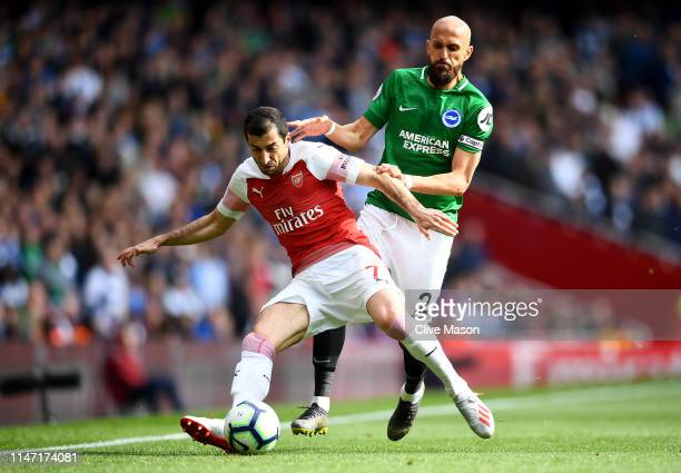 Henrikh Mkhitaryan of Arsenal is challenged by Bruno Saltor Grau of Brighton and Hove Albion during the Premier League match between Arsenal FC and...