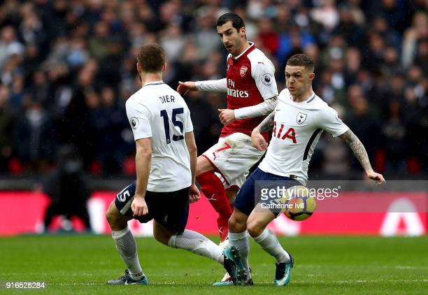 Henrikh Mkhitaryan of Arsenal is challenged by Eric Dier and Kieran Trippier of Tottenham Hotspur during the Premier League match between Tottenham...