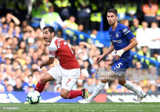 Henrikh Mkhitaryan of Arsenal is challenged by Jorginho of Chelsea during the Premier League match between Chelsea FC and Arsenal FC at Stamford...