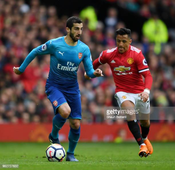 Henrikh Mkhitaryan of Arsenal is closed down by Alexis Sanchez of Manchester United during the Premier League match between Manchester United and...