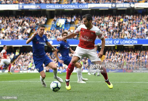 Henrikh Mkhitaryan of Arsenal is closed down by Jorginho of Chelsea during the Premier League match between Chelsea FC and Arsenal FC at Stamford...