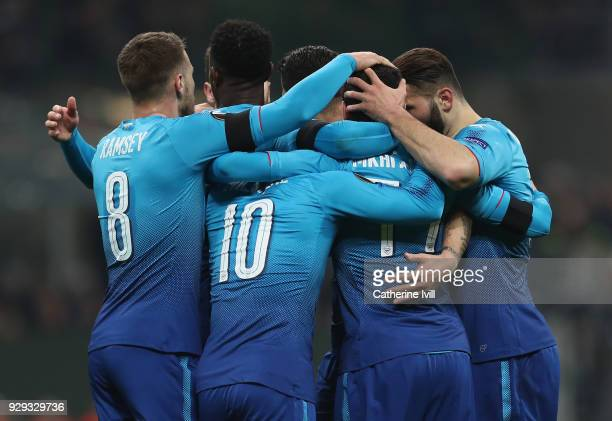 Henrikh Mkhitaryan of Arsenal is congratulated by teammates after scoring during the UEFA Europa League Round of 16 match between AC Milan and...
