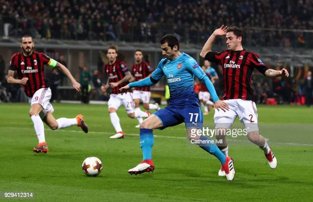 Henrikh Mkhitaryan of Arsenal is surrounded by AC Milan players during the UEFA Europa League Round of 16 match between AC Milan and Arsenal at the...
