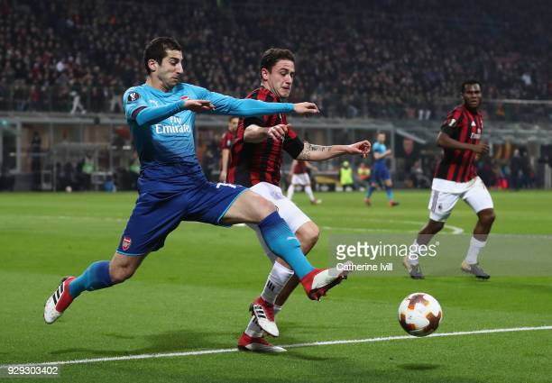 Henrikh Mkhitaryan of Arsenal is tackled by Davide Calabria of AC Milan during the UEFA Europa League Round of 16 match between AC Milan and Arsenal...