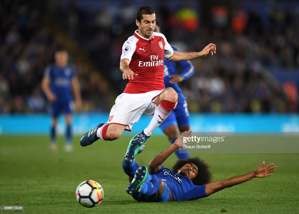 Henrikh Mkhitaryan of Arsenal is tackled by Hamza Choudhury of Leicester City during the Premier League match between Leicester City and Arsenal at The King Power Stadium on May 9, 2018 in Leicester, England.