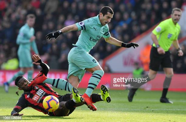 Henrikh Mkhitaryan of Arsenal is tackled by Jefferson Lerma of AFC Bournemouth during the Premier League match between AFC Bournemouth and Arsenal FC...