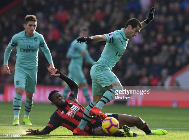 Henrikh Mkhitaryan of Arsenal is tackled by Jefferson Lerma of Bournemouth during the Premier League match between AFC Bournemouth and Arsenal FC at...