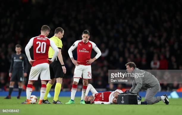 Henrikh Mkhitaryan of Arsenal lies injured during the UEFA Europa League quarter final leg one match between Arsenal FC and CSKA Moskva at Emirates...