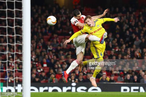 Henrikh Mkhitaryan of Arsenal misses a chance while being challenged by Aleksandar Filipovic of FC BATE during the UEFA Europa League Round of 32...