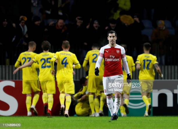 Henrikh Mkhitaryan of Arsenal reacts as BATE Borisov players celebrate a goal in background during the UEFA Europa League Round of 32 First Leg match...
