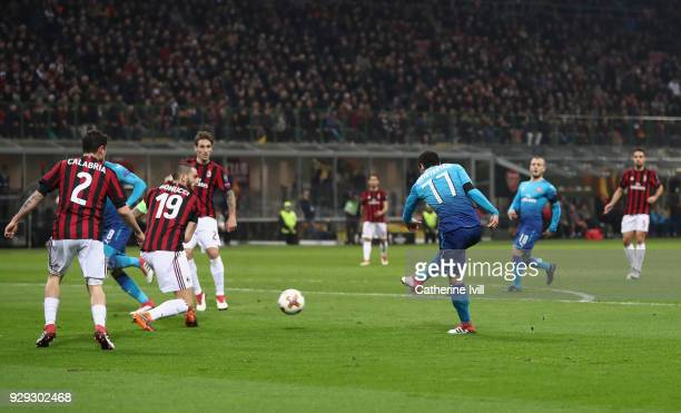 Henrikh Mkhitaryan of Arsenal scores during the UEFA Europa League Round of 16 match between AC Milan and Arsenal at the San Siro on March 8 2018 in...