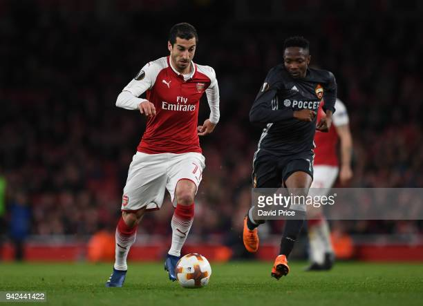 Henrikh Mkhitaryan of Arsenal takes on Ahmed Musa of CSKA during the UEFA Europa League quarter final leg one match between Arsenal FC and CSKA...