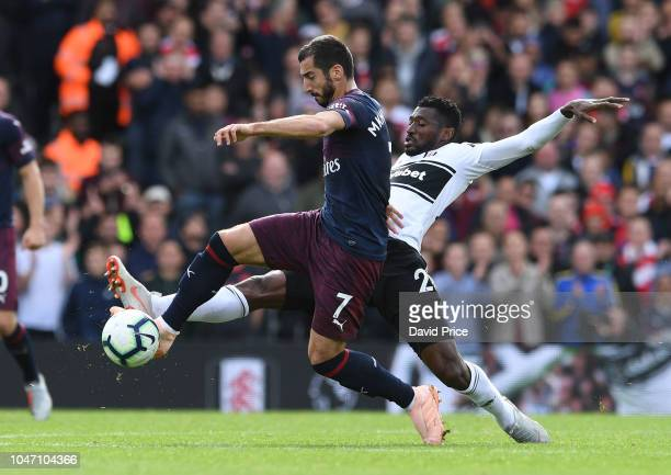 Henrikh Mkhitaryan of Arsenal takes on AndreFrank Zambo Anguissa of Fulham during the Premier League match between Fulham FC and Arsenal FC at Craven...