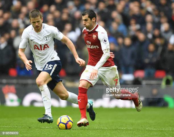 Henrikh Mkhitaryan of Arsenal takes on Eric Dier of Tottenham during the Premier League match between Tottenham Hotspur and Arsenal at Wembley...