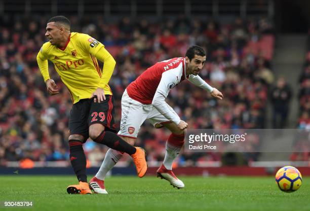 Henrikh Mkhitaryan of Arsenal takes on Etienne Capoue of Watford during the Premier League match between Arsenal and Watford at Emirates Stadium on...