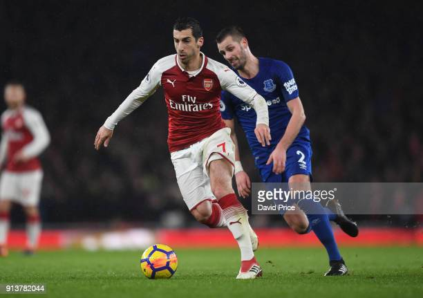 Henrikh Mkhitaryan of Arsenal takes on Morgan Schneiderlin of Everton during the match the Premier League match between Arsenal and Everton at...