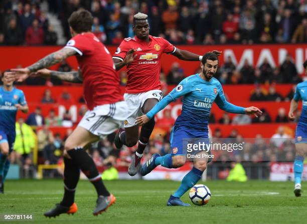 Henrikh Mkhitaryan of Arsenal takes on Paul Pogba of Man Utd during the Premier League match between Manchester United and Arsenal at Old Trafford on...