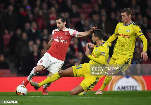 Henrikh Mkhitaryan of Arsenal takes on Yegor Filipenko of BATE during the UEFA Europa League Round of 32 Second Leg match between Arsenal and BATE...