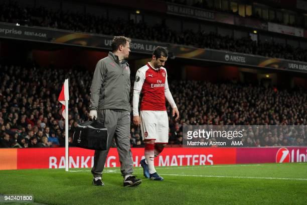 Henrikh Mkhitaryan of Arsenal walks for treatment after picking up an injury during the UEFA Europa League Quarter Final First Leg match between...