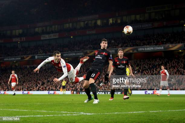 Henrikh Mkhitaryan of Arsenal with a diving header during the UEFA Europa League Round of 16 2nd leg match between Arsenal and AC MIian at Emirates...
