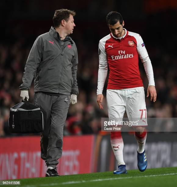 Henrikh Mkhitaryan of Arsenal with Physio Colin Lewin during the UEFA Europa League quarter final leg one match between Arsenal FC and CSKA Moskva at...