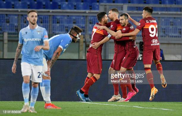 Henrikh Mkhitaryan of AS Roma celebrates a opening goal with his team mates during the Serie A match between AS Roma and SS Lazio at Stadio Olimpico...