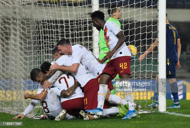 Henrikh Mkhitaryan of As Roma celebrates after scoring the 1-3 goal with team mates during the Serie A match between Hellas Verona and AS Roma at...