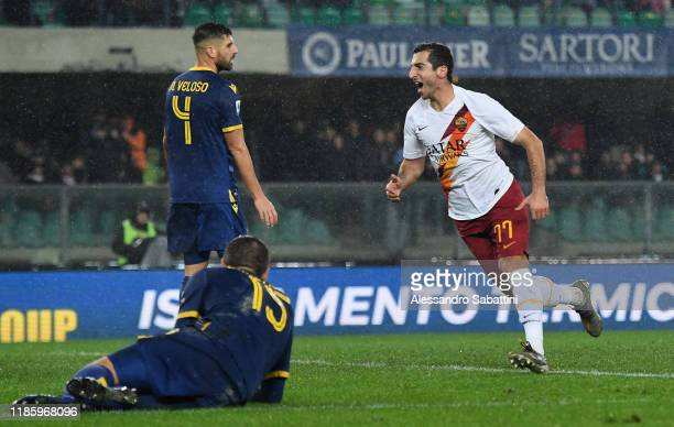 Henrikh Mkhitaryan of As Roma celebrates after scoring the 1-3 goal during the Serie A match between Hellas Verona and AS Roma at Stadio Marcantonio...