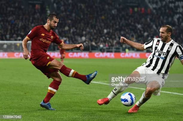 Henrikh Mkhitaryan of AS Roma challenged by Giorgio Chiellini of Juventus during the Serie A match between Juventus and AS Roma at Allianz Stadium on...