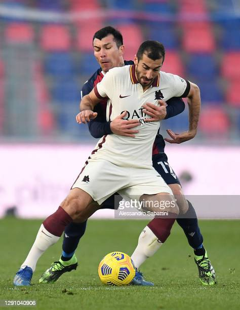 Henrikh Mkhitaryan of AS Roma competes for the ball with Gary Medel of Bologna FC during the Serie A match between Bologna FC and AS Roma at Stadio...