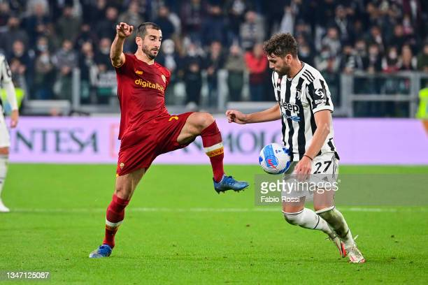 Henrikh Mkhitaryan of AS Roma in action during the Serie A match between Juventus and AS Roma at on October 17, 2021 in Turin, Italy.