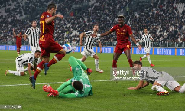 Henrikh Mkhitaryan of AS Roma is brought down by Wojciech Szczesny of Juventus earning himself a yellow card and conceeding a penalty in the process...
