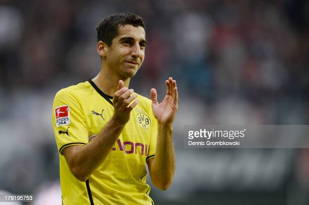 Henrikh Mkhitaryan of Borussia Dortmund celebrates after the Bundesliga match between Eintracht Frankfurt and Borussia Dortmund at Commerzbank Arena...